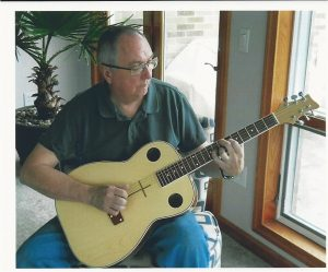 John Ledford playing guitar
