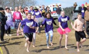 "Five young members of the Wings of Hope Relay for Life team from Carroll County ""plunged"" into the cold water of Atwood Lake Saturday as part of the American Cancer Society's Polar Bear Plunge.  Team members shown running down the beach toward the lake are (from left): Triston Hartong, Briana Amstutz, Penelope Menarcheck, Nikki Rummell and Colton Amstutz."