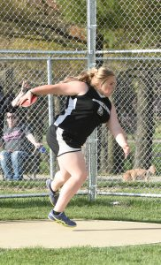 Alivia Bentley winds up as she prepares to throw the discus last week against Alliance. Bentley won the discus and the shot put.