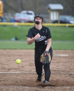 Shelbee Stidom, who threw a perfect game against Canton Central Catholic last week, releases the ball during a home game against Minerva.