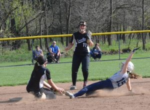 Warrior Rickee Stidom (back to camera) applies the tag to a Marlington runner as teammate Kaitlin Shine (11) provides backup during a game last week at Carrollton.
