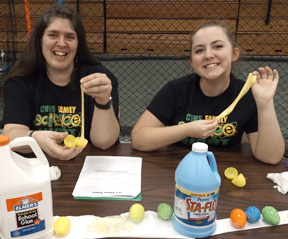 Conotton Valley math teacher Amanda Haney (left) and Alexis Bartholomew were one of the most popular booths at the school science fair. The pair made slime and distributed it to students in plastic eggs.