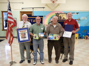 AT  RIGHT: Members of the Rotary Club of Malvern presented Dr. Andrew Opritza the Paul Harris Fellow Award. Shown at right are: Jack Polen; Randy Smith, club president; Dr. Opritza and Roger Bartley.