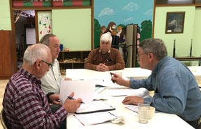 Malvern Rotary Club members (from left) Randy Smith, Roger Bartley, Gary Pearce and Wally Anderson discuss plans for the upcoming Field of Honor during a recent meeting.