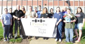 "Several students who signed the ""I promise"" pledge joined members of a grassroots effort to keep students safe prom weekend. They are shown above in front of the school. Standing in front are: Quinn Meredith, Sheriff Dale Williams, Dr. Mandal Haas, Darcy Bolanz, Margaret Mesler and Michael Mazalic.  Standing behind are: Kate Payne deChavez, Sarah Wilsford, Nate Allen, Camron Roma, Dina Gomez, Belinda Mach and Eric McCauley."