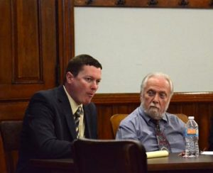 Kenneth Blanchard (right) sits at the defense table with Attorney Stephen Kandel.