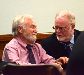 Kenneth Blancard (left) smiles at his attorney, Jeff Jakmides, before leaving the courtroom Monday.