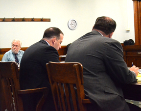 Prosecutors Steven Barnett (right) and Paul Scarella review case materials as the defendant, Kenneth Blancard, sits at the defense table during Blanchard's murder trial May 18,