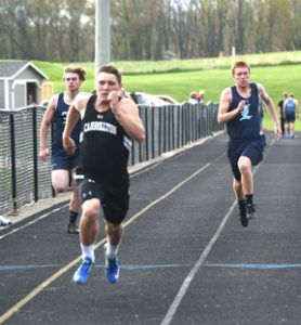 Chase Flanagan crosses the finish line first in the 100-meter run against Louisville last week.