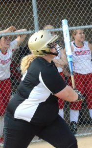 Brenna Campbell watches as the ball sails toward the fence in centerfield before she leaves home plate to run the bases on a three-run home run against West Holmes in the district title game last week.