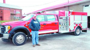 Loudon Twp. Fire Department Chief John Beckley Jr. stands in front of the department's new pumper truck acquired with assistance from a Federal Emergency Management  Agency (FEMA) Assistance to Firefighters Grant (AFG).