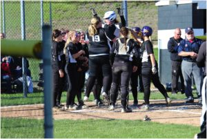 Carrollton Senior, Brenna Campbell (19) chest bumps sophomore Zoe Drake after Drake's home run in the bottom of the fourth inning against East Liverpool.