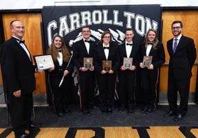 Senior members of the Carrollton High School band who received special awards during the May 8 spring concert are shown above. They are (from left): Dave Dickerhoof, band director; Quinn Meredith, John Philip Sousa award winner; Camron Roma, Miranda Lohman, Jay Stoneman and Adaline Kinney, all director's award winners, and Pete Woodruff, assistant director.