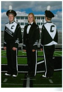 The new style Carrollton High School band uniform is shown being modeled by Olan Domer (left and far right) and Layna Pasiuk.