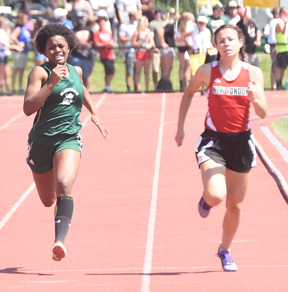 Zoe Moser (left) heads down the track toward a fifth place finish in the 200 meter dash.