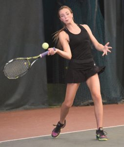 Taylor Fair strikes the tennis ball with her raquet during a match at the district tennis tournament Oct. 12 at Ohio University in Athens. Fair finished second and will compete at the state tournament Oct. 21-22.