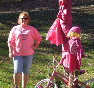 AWARENESS ADVOCATE. Wendy Ledger is shown above with items she placed in her yard to bring awareness to breast cancer during October. (FPS/Leigh Ann Rutledge)