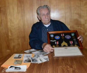 Ed Ondusko displays memorabilia from his service in the US Army Air Corps. Along with a collection of photos and certificates are medals he received. They include: American Defense, European Theater, WWII Victory, Army of Occupation, Good Conduct and the Berlin Airlift. (FPS/Carol McIntire)