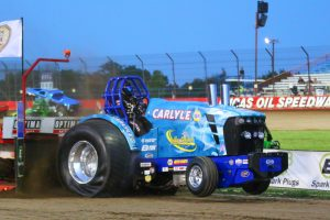 Jeff Hothem heads down the track on the NAPA/Carlyle Tools Fully Loaded John Deere at Wheatland, MO. Hothem clinched the the Unlimited Super Stock class championship with a second place finish at the pull.  (Photo courtesy of JP Pulling Productions )
