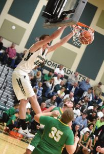 Malvern junior Mark Mayle (40) slams the basketball through the rim en route to Malvern's 84-51 win over Conotton Valley. Mayle finished with 20 points. (FPS/Jordan Miller)