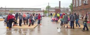 Rainy weather didn't dampen the spirits of Bell-Herron Middle School students who completed the PBIS(Postitive Behavior Internvention and Support) program with a house build May 11 on the basketball court at the school. Several students are shown above constructing inside walls for the home.