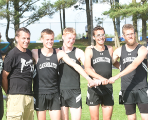 The Carrollton Boys 4x8 relay team finished first and qualified for the Regional meet at Athens this week. Members are shown above with Coach Mike Aukerman. From left are:Aukerman, Quinton Huggett, Cole Lovett, Dan Lampe and Preston Berry.