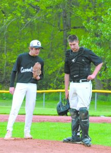 Carrollton pitcher Trevor Boggess (left) and catcher Jacob Grubbs have a conference on the mound during a game against East Canton last week.