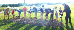 Elementary students who earned the opportunity to participate in the groundbreaking for the new school during the groundbreaking event May 18 are shown above digging the first shovels of dirt.  Shown above from left are:  Demi Leary, Benjamin Hamilton, Dillon Hall, Kasee Gallo, Bryce Hartong, Abigail Zeedyk, Kolton Barker, Evan Brace, Kaden Hamilton, Connor Lowdermilk, Gavin Sanders and Dr. David Quattrochi, superintendent of Carrollton Schools.