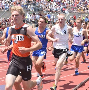 Carrollton senior Cole Lovett sprints down the home stretch to a first place finish in the Division II1,600 meter run Saturday at the state track meet.